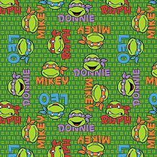 """TMNT Ninja Turtles Faces Green Knit 96% cotton 4% Spandex 58"""" fabric by the yard"""
