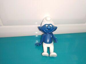 Figurine smurf Schtroumpf Puffi Schlumpfe pilote de la voiture burago