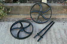 A PAIR OF BLACK CAST IRON WHEELS WITH AXLES - HEN HOUSE WHEELS STATIONARY ENGINE