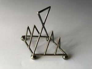 Christopher Dresser style silver-plated toast rack. Very nice item, small and...