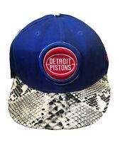 New Era Detroit Pistons SnapBack Hat Snakeskin Print Brim Black White Blue Red
