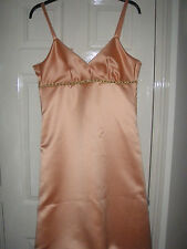 adult  peach/duches satin and two childrens bridesmaids dresses