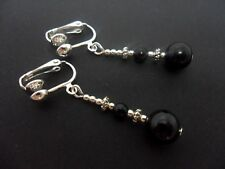 A PAIR OF DANGLY BLACK ONYX  SILVER PLATED CLIP ON   EARRINGS.