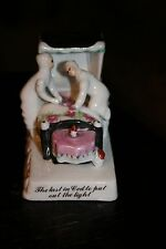 "Staffordshire Porcelain Fairing Figurine Titled ""last in bed to put out light"""