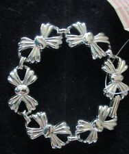 """BOW BRACELET SMALL 7"""" LONG **NEW WITH TAG ON**DOES NOT TARNISH**SILVER-TONE"""