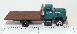 N Scale Flat Bed Truck with a Green Cab