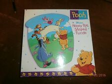 winnie the pooh 24 piece puzzel honey pot shaped