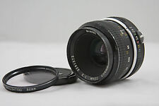 NIKON NON-AI 50MM F2  NIKKOR CAMERA LENS WITH SKYLIGHT FILTER