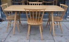 A set of four vintage Ercol dining chairs and a plank dining table
