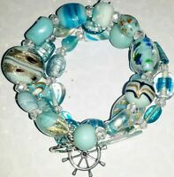 Memory Wire Bracelet with Light Blue Glass Beads  Charms on ends FREE SHIPPING