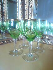 4 superb white wine glasses,green with gold rim.