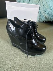 Black Wedge Heel Broques 6
