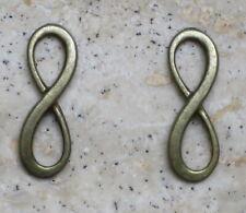 """2 connecteurs """"Infini"""" pour rangs de perles DIY métal bronze fabrication bijoux"""