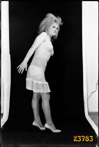 woman in camisole, nylon stockings, strange hair 1970s vintage fine art negative
