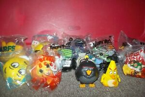 Lot of 12 McDonalds Happy Meal Toys NIP most Sealed Angry Birds Skylander Smurfs