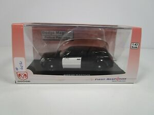 FIRST RESPONSE 1/43 UNMARKED BLACK/WHITE DODGE MAGNUM POLICE UNIT *CASE ISSUE**