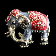 Brosche Indischer Elefant, goldfarbenes Metall, grau und rot emailliert
