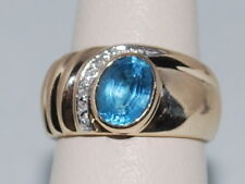 14k Gold ring with blue topaz(Dec birthstone) and diamonds