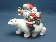 Santa Claus riding on back of polar bear with polar Cub in bag