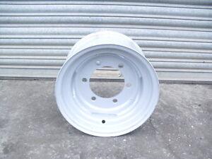 Agricultural trailer wheel rim 9 x 15.3