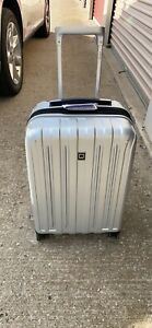 DELSEY Paris Carry-On Hard Case Spinner Suitcase, Silver, 21 inch
