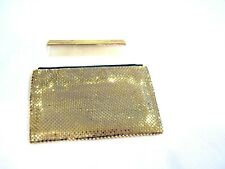 Whiting and Davis gold metal mesh wallet with original comb, c. 1950s