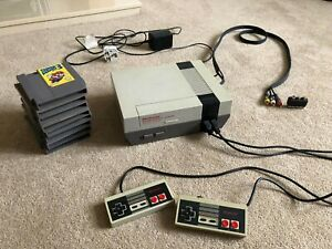 Nintendo Entertainment System NES Console, 2 controllers, and 8 Games!