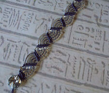 Micro macrame bracelet with purple and clear crystals.