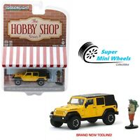 Greenlight 1:64 Hobby Shop 2015 Jeep Wrangler Unlimited Rubicon with Backpacker