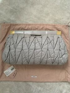 Completely Authentic Miu Miu Grey Matelasse Clutch Bag