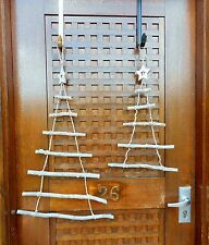 TWO PINE STICK & ROPE HANGING CHRISTMAS TREES WITH WOODEN STAR