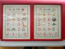 A PAIR OF 20TH CENTURY FRAMED SAMPLERS◾ALPHABET/ANIMALS ETC.◾UNSIGNED