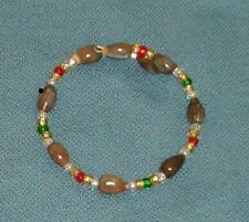 Bracelet: Brown Hawaiian Job's Tears with silver lined seed beads red green gold