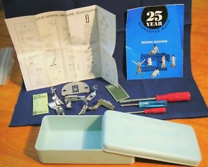 Vintage Brother sewing machine accessories attachments light blue box feet tools