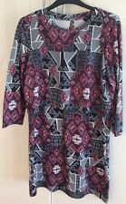 Topshop, Dress size 12. Patterned, worn once. Cape style