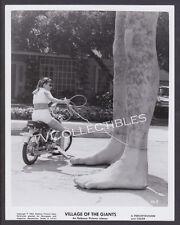 8x10 Photo~ VILLAGE OF THE GIANTS ~1965 ~Girl on bike ties up giant legs