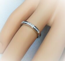 Sterling silver channel set eternity ring.Hallmarked 925 size Q {No.11}