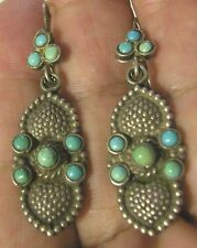 A FINE PAIR OF STERLING SILVER HAND MADE EARRINGS SET WITH 16 TURQUOISE STONES