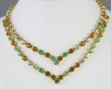 Collier ras du cou—Métal doré serti de strass ocres, verts et jaune—Années 70