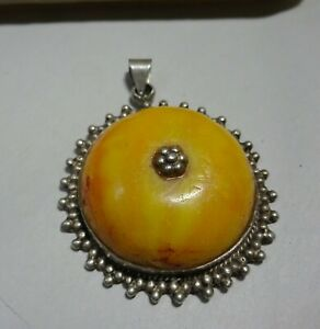 A Beautiful Silver Ethnic Pendant with Egg Yolk Amber Center