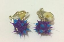 Great fun small spikey earrings in rubber like material purple and blue