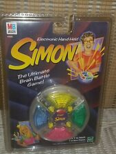 "SIMON Electronic Hand Held Game ""The Ultimate Brain Battle Game"" 1999 Brand New"