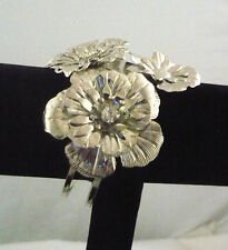 Hinged cuff bracelet silver tone metal with 3 raised flowers 2 with rhinestones