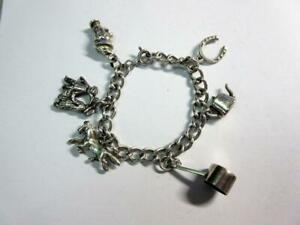 Vintage SOLID SILVER CHILDS CHARM BRACELET with 6 SILVER CHARMS - 18.4g!