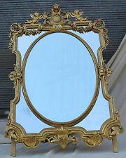 Miroir N3 aux anges, parecloses et médaillon central ovale biseauté,doré feuille