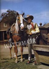 WESTERN ACTOR ROY ROGERS AND TRIGGER STANDING FOR CAMERA COLOR PUBLICITY PHOTO