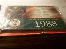 1988 AMERICAN SILVER EAGLE $1 COLORIZED, WITH HISTORY CARD/ CERT OF AUTHENTIC.