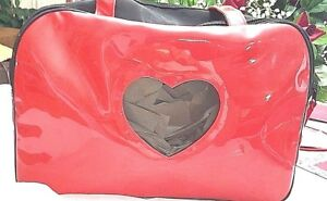 RED DOG CARRIER, HEART WINDOW OPENING