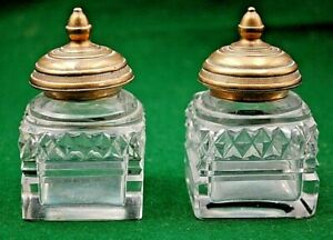 A PAIR OF ANTIQUE GLASS SQUARE BASED INKWELLS