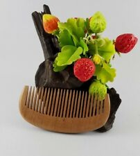 Hair comb made of wood with fragrance. Stimulates the scalp to circulate blood.